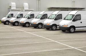 fleet of white vans in parking lot Lake Arbor Automotive & Truck Westminster Colorado