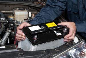 Auto mechanic replacing car battery Lake Arbor Automotive & Truck Westminster Colorado