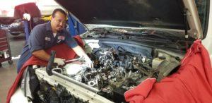 Auto Repair & Maintenance mechanic working under hood of car Lake Arbor Automotive Westminster