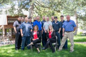 Team photo taken outside Lake Arbor Automotive & Truck Westminster Colorado