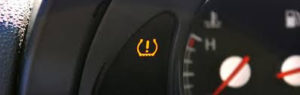 close up of tire pressure indicator on car dash Lake Arbor Automotive Westminster