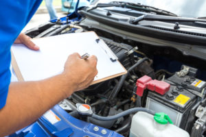 mechanic performing vehicle inspection Lake Arbor Automotive & Truck Westminster Colorado