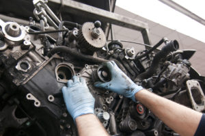mechanic working on vehicle Lake Arbor Automotive & Truck Westminster Colorado