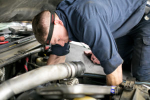 mechanic performing tune up Lake Arbor Automotive & Truck Westminster Colorado